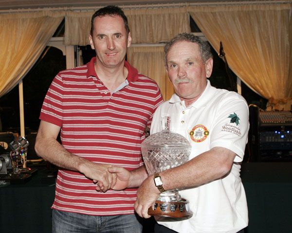 Eamon Daly receiving the Condon brothers' memorial trophy
